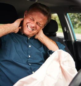 Male Motorist With Whiplash Injury In Car Crash With Airbag Deployed